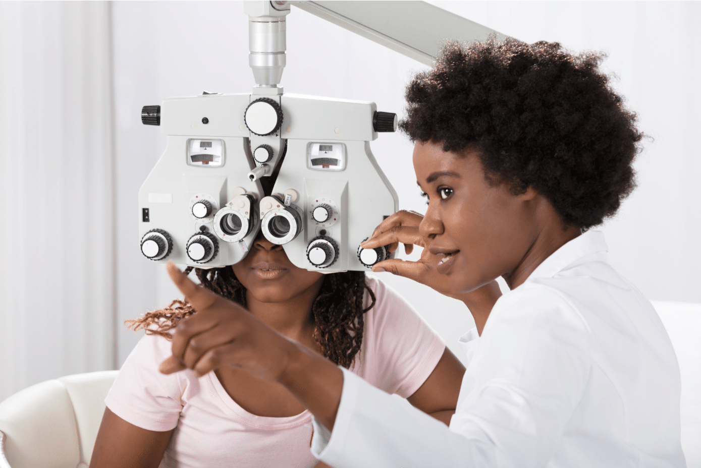 Female optometrist checking a patient's eyesight